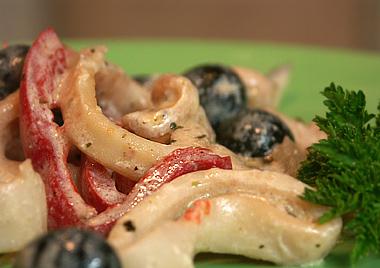Тушеные кальмары с маcлинами